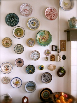 Plates from Elizabeth's travels adorn the kitchen wall. I think this is beautiful.