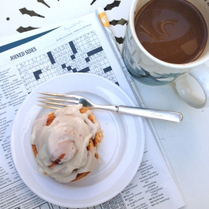"Saturday, May 10th, morning with previous week's NYT Corssword puzzle & cinnamon roll from ""flour.sugar.eggs"" Nashville"